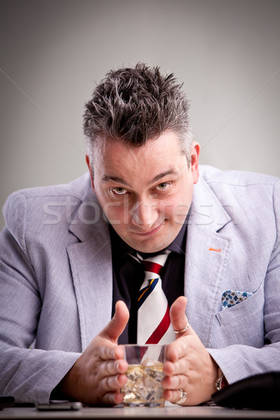 clever businessman with his drink Stock photo © Giulio_Fornasar