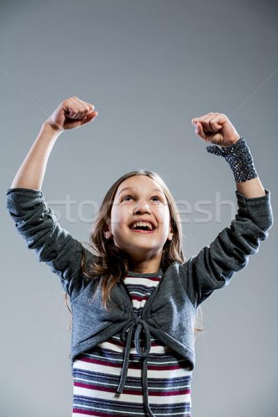 little girl rising up her arms joyfully Stock photo © Giulio_Fornasar