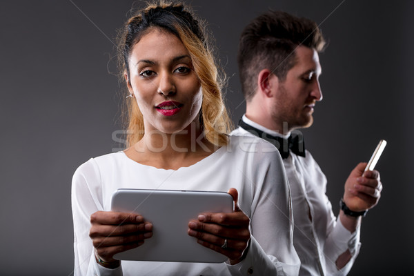 woman with tablet and man with mobile phone Stock photo © Giulio_Fornasar