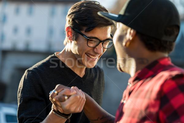 Jó barátok viccelődés titok kézfogás kéz Stock fotó © Giulio_Fornasar
