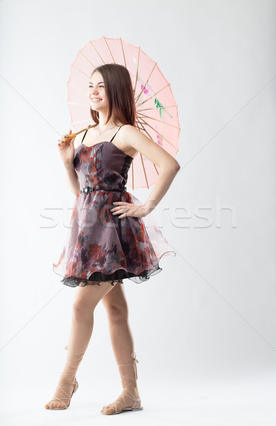 girl with a Chinese pink umbrella Stock photo © Giulio_Fornasar