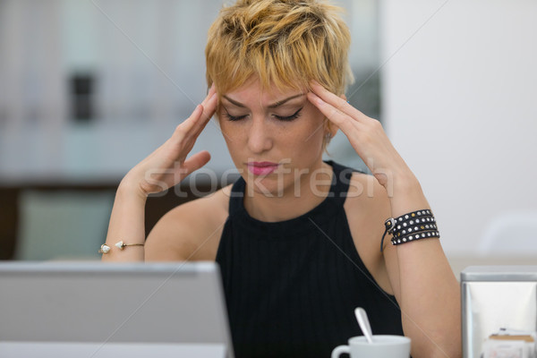 Attractive stylish young woman with a headache Stock photo © Giulio_Fornasar