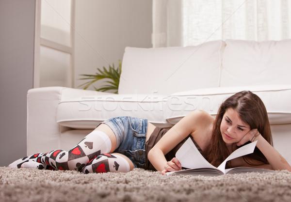 pretty girl reading a book on her rug Stock photo © Giulio_Fornasar