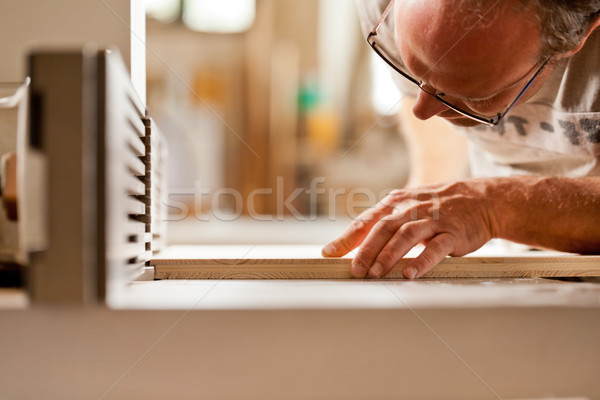 carpenter checking board on a wood shaper Stock photo © Giulio_Fornasar