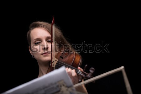 violinist reading music score and playing Stock photo © Giulio_Fornasar