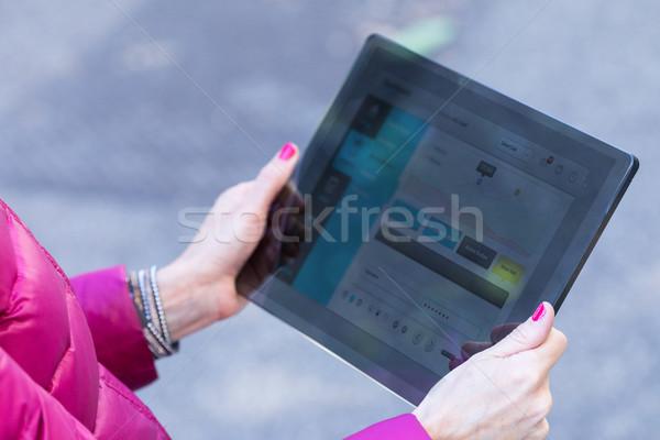 woman using a transparent digital tablet Stock photo © Giulio_Fornasar