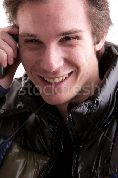 smiling young man on the phone Stock photo © Giulio_Fornasar