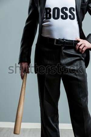 Cropped view of man with bat and boss on shirt Stock photo © Giulio_Fornasar
