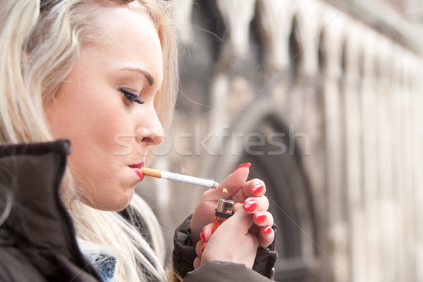 tourist lighting up a a cigarette in an European city Stock photo © Giulio_Fornasar
