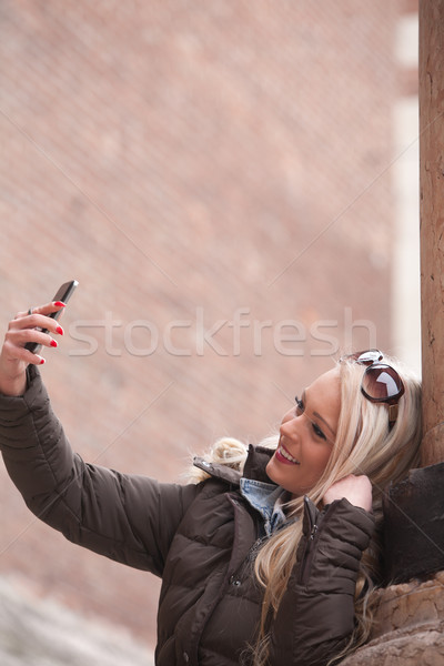 blonde tourist making a selfie outdoors Stock photo © Giulio_Fornasar