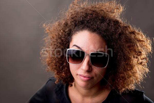 Düşünmek genç kadın güneş gözlüğü izlerken şüpheci Stok fotoğraf © Giulio_Fornasar