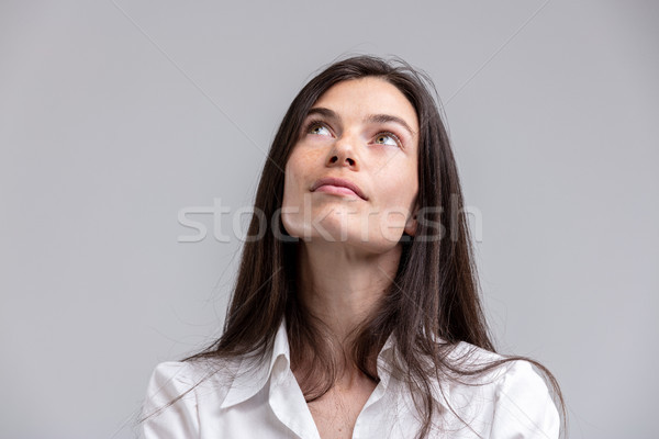 Thoughtful attractive woman looking up Stock photo © Giulio_Fornasar