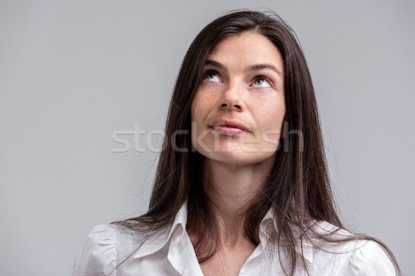Attractive woman deep in thought looking up Stock photo © Giulio_Fornasar