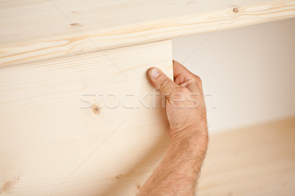 hand placing wooden board in place Stock photo © Giulio_Fornasar