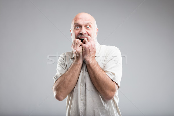scared man biting his nails because of fear Stock photo © Giulio_Fornasar