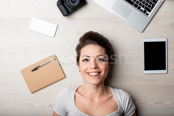 Smiling happy woman surrounded by office supplies Stock photo © Giulio_Fornasar