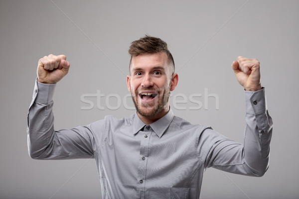 Exuberant man cheering and punching the air Stock photo © Giulio_Fornasar