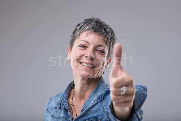 Happy enthusiastic lady giving a thumbs up Stock photo © Giulio_Fornasar