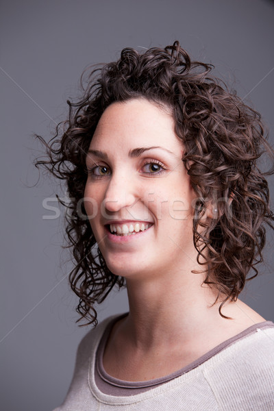 foreground portrait of a smiling curly haired woman Stock photo © Giulio_Fornasar