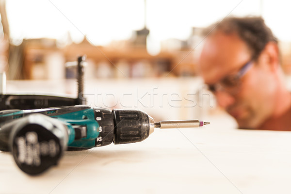 fastener drive in focus and woodworker on background Stock photo © Giulio_Fornasar