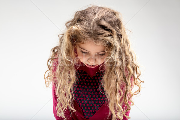 Sad curly-haired schoolgirl with head down Stock photo © Giulio_Fornasar