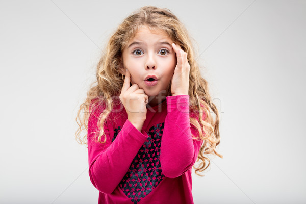 Cute little girl with a look of astonishment Stock photo © Giulio_Fornasar