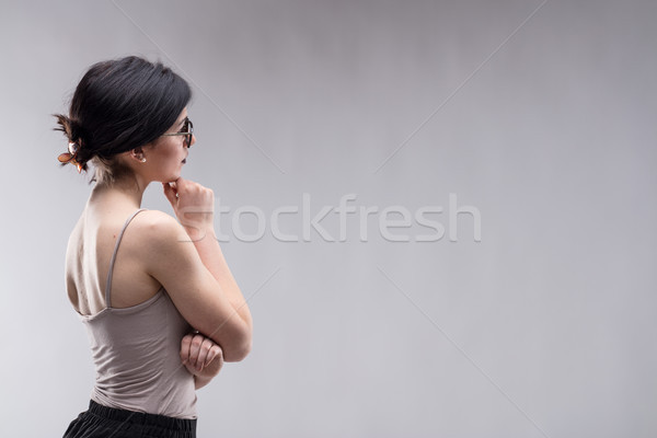 Young brunette woman looking at copy space Stock photo © Giulio_Fornasar