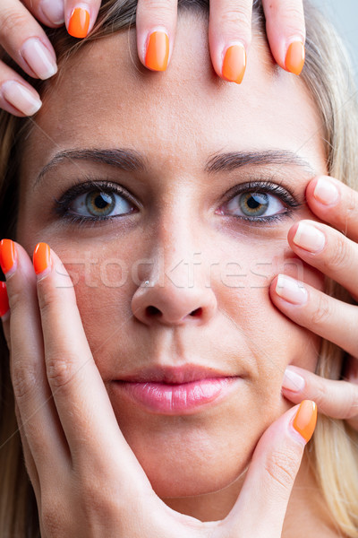 Woman with female hands caressing her face Stock photo © Giulio_Fornasar