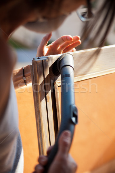 Woman removing sawdust from a window Stock photo © Giulio_Fornasar