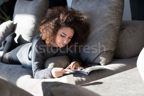 Bogate dziewczyna czytania coś sofa Zdjęcia stock © Giulio_Fornasar