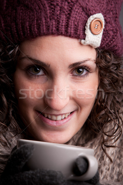 smiling woman with a mugful of a hot drink Stock photo © Giulio_Fornasar
