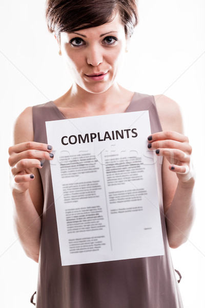 Thoughtful woman holding a list of complaints Stock photo © Giulio_Fornasar