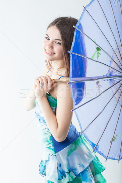 beautiful girl nicely smiling with a blue Eastern parasol Stock photo © Giulio_Fornasar