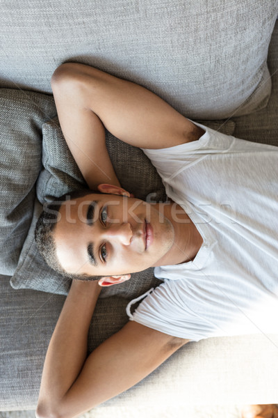 Man relaxing on sofa and looking at camera Stock photo © Giulio_Fornasar