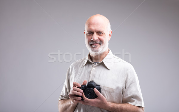 photographer holding a DSLR in his hands Stock photo © Giulio_Fornasar
