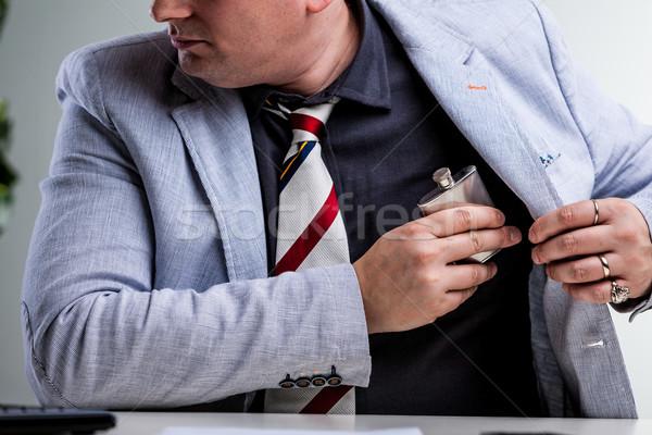 Trabalhador de escritório ocultação interno bolso local de trabalho Foto stock © Giulio_Fornasar