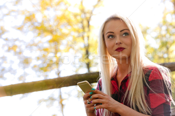 nice woman with mobile outdoors Stock photo © Giulio_Fornasar