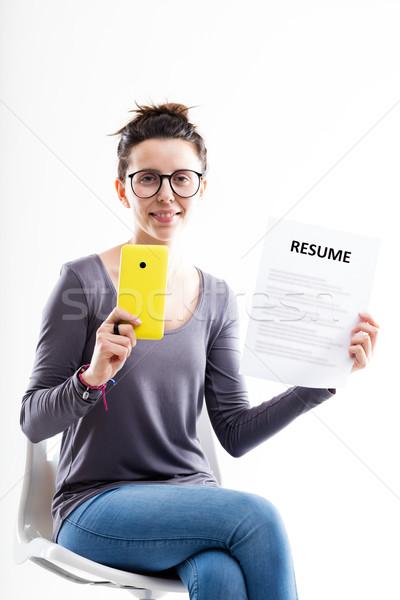 Nő ül okostelefon önéletrajz fiatal nő szemüveg Stock fotó © Giulio_Fornasar