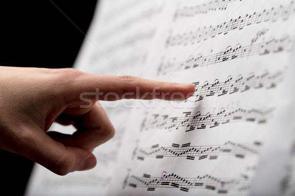finger pointing to music score Stock photo © Giulio_Fornasar