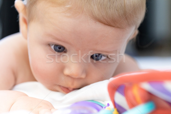 Stock photo: Cute little baby looking at its toys