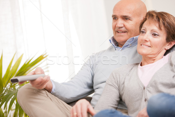 mature couple watching tv on the sofa Stock photo © Giulio_Fornasar