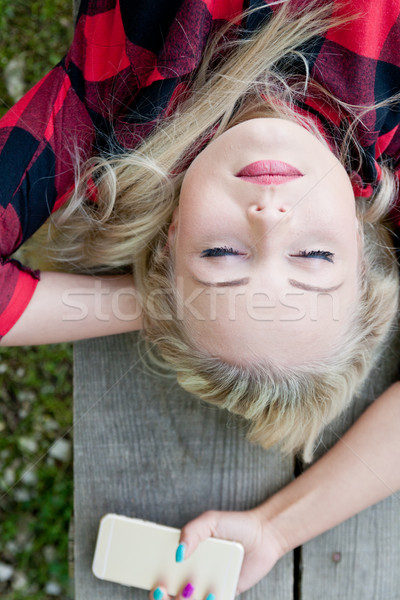 woman sleeping on the bench of a park Stock photo © Giulio_Fornasar