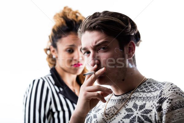 Hombre fumar mujer decepción humo cigarrillo Foto stock © Giulio_Fornasar