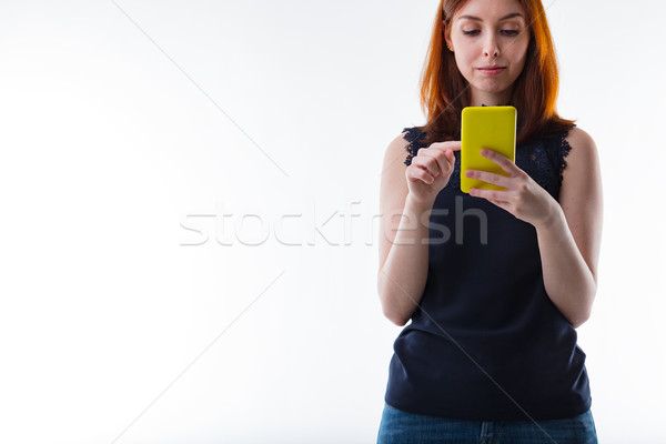 woman texting with her mobile alongside wide copyspace Stock photo © Giulio_Fornasar