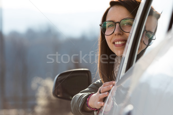 woman looking back from her car Stock photo © Giulio_Fornasar