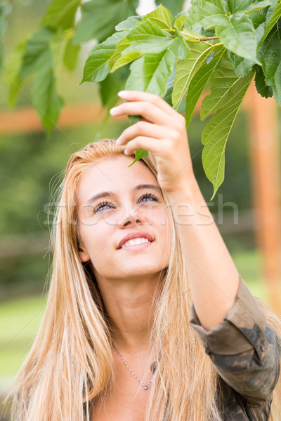girl outdoors touching a leaf Stock photo © Giulio_Fornasar
