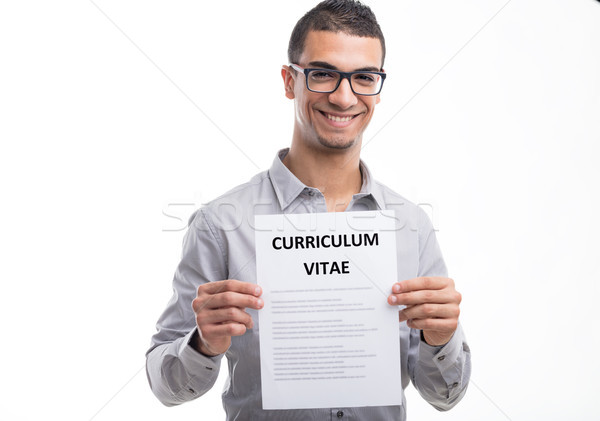 Young smiling man holding curriculum vitae Stock photo © Giulio_Fornasar
