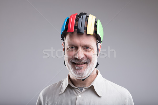 smiling old man wearing a bike helmet Stock photo © Giulio_Fornasar