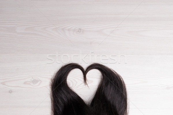 hair in shape of heart on wood Stock photo © Giulio_Fornasar