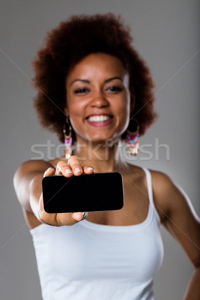 afroamerican woman showing mobile phone Stock photo © Giulio_Fornasar